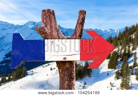 France Flag wooden sign with winter background
