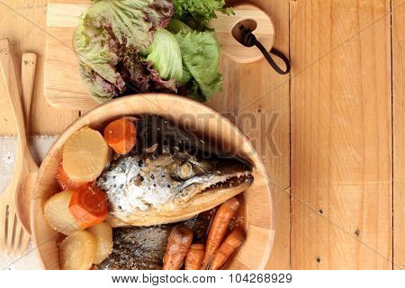 Salmon Head Cooked Of Tari Yaki Sauce With Fresh Vegetables.