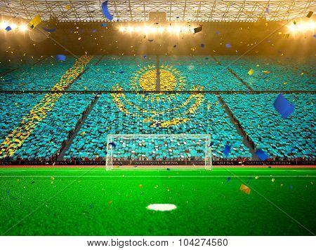 Flag Kazakhstan of fans. Evening stadium arena Yellow