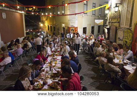 People Having Dinner Outdoor In Calcada Do Duque In Lisbon