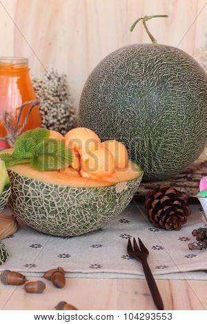 Orange cantaloupe melon fruit juicy on wood background poster