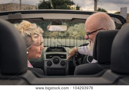Husband and wife travelling by car