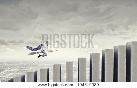 Young businessman flying on broom and growth concept poster