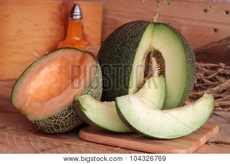 Cantaloupe melon fruit juicy on wood background poster