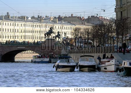 River cruise passenger boats moored on Griboedov channel
