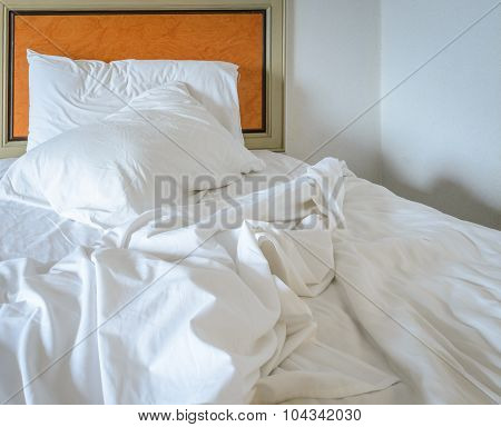 Messy Unmade Bed With Pillow