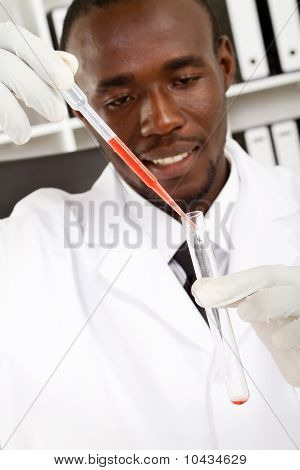 african scientist conducting experiment