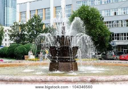 EKATERINBURG RUSSIA - JULY 31. Fountain Stone flower at the Historical square in the center of Ekaterinburg
