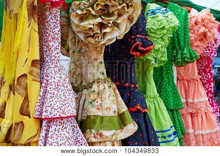Andalusian gypsy dresses in a row at Spain outdoor market