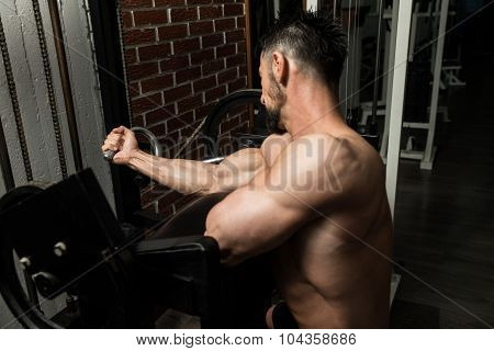 Athlete Man Doing Heavy Weight Exercise For Biceps poster