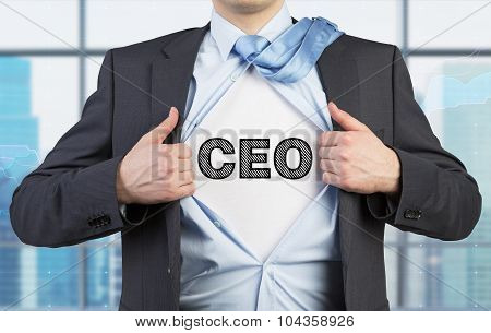 A Man In A Suit Is Tearing The Blue Shirt. Acronym Ceo Is Drawn On The Chest. Modern Panoramic Offic
