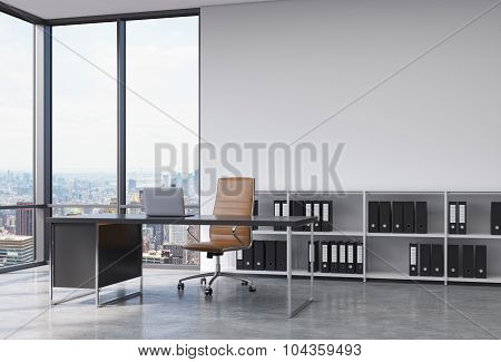 A Ceo Workplace In A Modern Corner Panoramic Office With New York City View. A Black Desk With A Lap