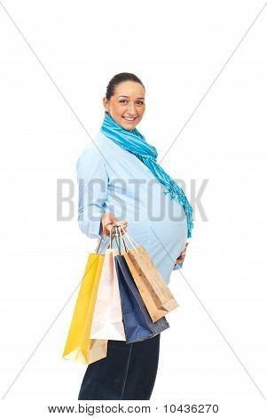 Happy Pregnant Woman At Shopping