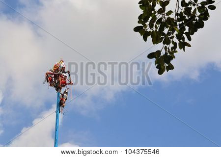 Playa del Carmen, Riviera Maya, Yucatan, Mexico - 19 August 2013: Acrobat performers, so-called Voladores, perform a Flying Men Dance ceremony near the beach of Playa del Carmen. The fertility ritual is a traditional Ceremony of Mayans.