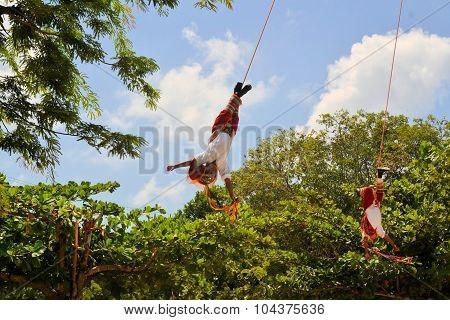 Playa del Carmen, Riviera Maya, Yucatan, Mexico - 19 August 2013: Acrobat performers, so-called Voladores, perform a Flying Men Dance ceremony near the beach of Playa del Carmen.