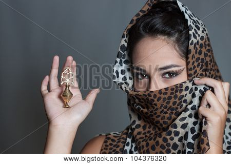 Indian Girl Face Covered Leopard Spotted Veil Holding Kajal Pot