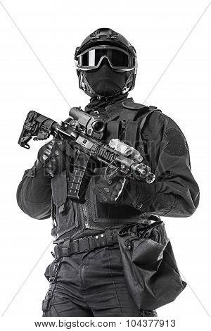 Spec ops police officer SWAT in black uniform and face mask studio shot poster