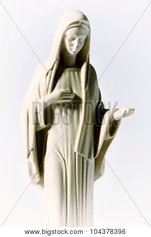 Statue Of The Virgin Mary On A White Background