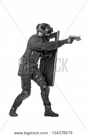 Spec ops police officer SWAT with ballistic shield studio shot poster