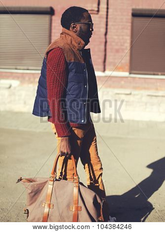 Fashion Handsome Stylish African Man Wearing A Vest Jacket, Sweater And Bag Walking In City Evening,