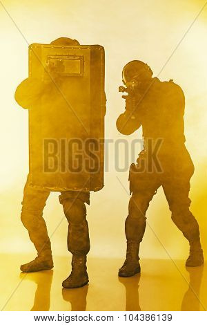 Police officers SWAT with ballistic shield