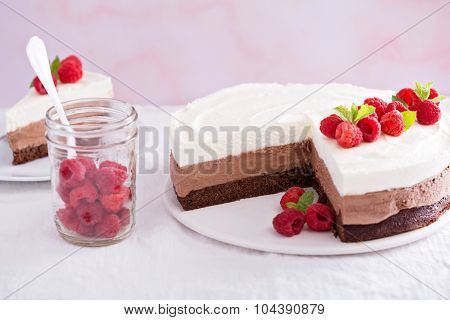 Three chocolate mousse cake slice on a small plate poster