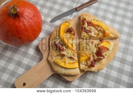 Home made pumpkin pizza with bacon