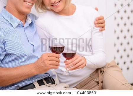 Adult couple drinking wine