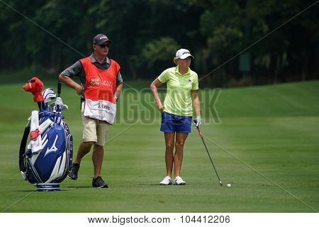 KUALA LUMPUR, MALAYSIA - OCTOBER 09, 2015: USA's Stacy Lewis discusses with her caddy on the sixth hole fairway of the KL Golf & Country Club at the 2015 Sime Darby LPGA Malaysia golf tournament.