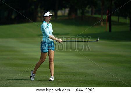 KUALA LUMPUR, MALAYSIA - OCTOBER 09, 2015: Germany's Sandra Gal plays from 6th hole fairway of the Kuala Lumpur Golf & Country Club at the 2015 Sime Darby LPGA Malaysia golf tournament.