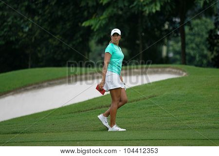 KUALA LUMPUR, MALAYSIA - OCTOBER 09, 2015: USA's Cheyenne Woods walks on the sixth hole fairway of the KL Golf & Country Club at the 2015 Sime Darby LPGA Malaysia golf tournament.