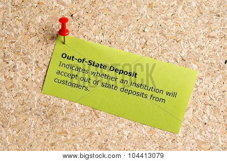 out of state deposit word typed on a paper and pinned to a cork notice board poster