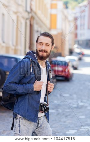 Attractive bearded guy is making journey across town