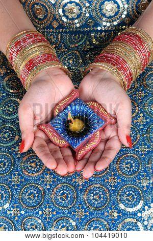 Diwali Celebration Diya On A Female Hand