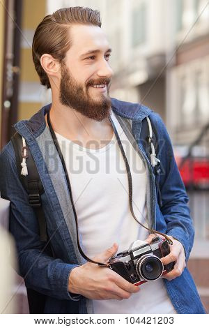 Cheerful young tourist is sightseeing with joy