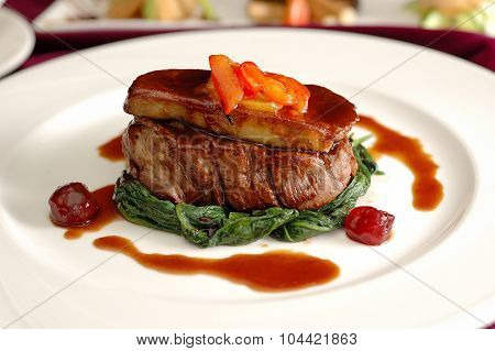 Tournedos Rossini. steak with foie gras. french steak dish with foie gras and croutons. poster