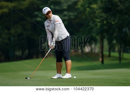 KUALA LUMPUR, MALAYSIA - OCTOBER 09, 2015: South Korea's Amy Yang prepares to hit from the 6th hole fairway at the KL Golf & Country Club at the 2015 Sime Darby LPGA Malaysia golf tournament.