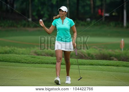 KUALA LUMPUR, MALAYSIA - OCTOBER 09, 2015: USA's Cheyenne Woods reacts after putting the 18th hole green at the KL Golf & Country Club at the 2015 Sime Darby LPGA Malaysia golf tournament.