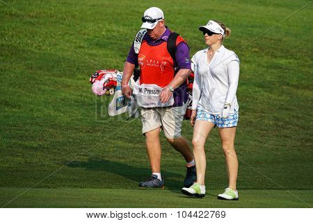 KUALA LUMPUR, MALAYSIA - OCTOBER 09, 2015: USA's Morgan Pressel discusses with her caddy at the 6th hole fairway of the KL Golf & Country Club at the 2015 Sime Darby LPGA Malaysia golf tournament.