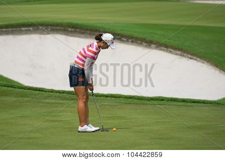 KUALA LUMPUR, MALAYSIA - OCTOBER 09, 2015: South Korea's Chella Choi putts at the 18th hole green at the KL Golf & Country Club at the 2015 Sime Darby LPGA Malaysia golf tournament.
