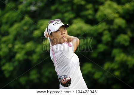 KUALA LUMPUR, MALAYSIA - OCTOBER 10, 2015: New Zealand's Lydia Ko tees off at the sixth hole of the KL Golf & Country Club on Round 3 day at the 2015 Sime Darby LPGA Malaysia golf tournament.