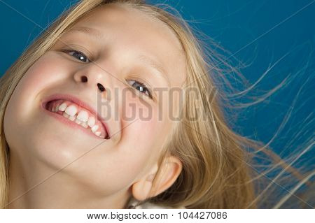 Girl With Toothy Smile