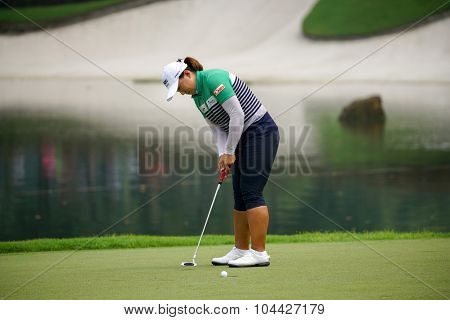 KUALA LUMPUR, MALAYSIA - OCTOBER 10, 2015: South Korea's Amy Yang putts on the green of the 18th hole of the KL Golf & Country Club during the 2015 Sime Darby LPGA Malaysia golf tournament.