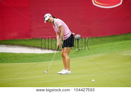 KUALA LUMPUR, MALAYSIA - OCTOBER 10, 2015: South Korea's So Yeon Ryu putts on the green of the 18th hole of the KL Golf & Country Club during the 2015 Sime Darby LPGA Malaysia golf tournament.
