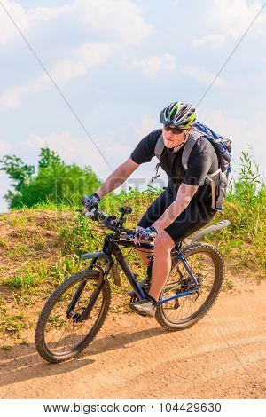 Cyclist Wearing A Helmet On A Mountain Bike Moves