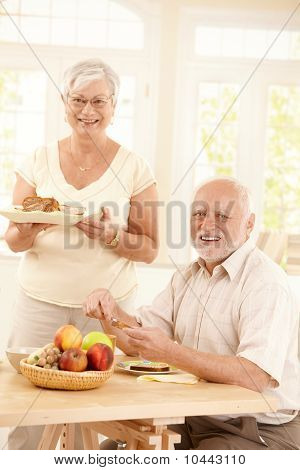 Portrait Of Happy Senior Couple At Breakfast