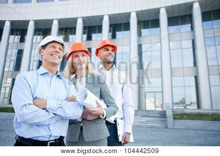 Skillful architects are discussing new plan of building