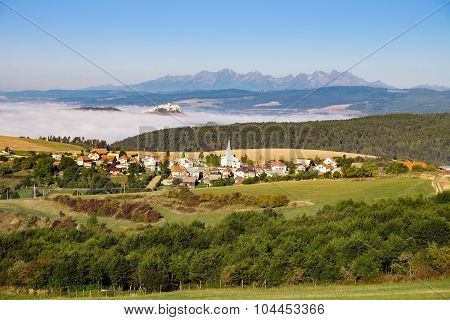 Scenic View Of Traditional Village, Castle, Meadows And Mountains, Slovakia
