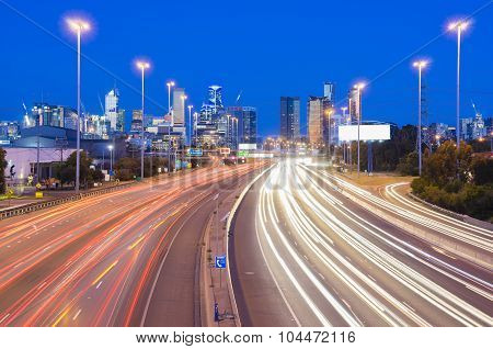 High speed traffic and light trails in highway at twilight