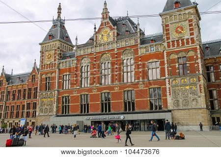 People In Front Of The Central Station Building In Amsterdam, Netherlands